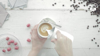 Flat White being poured into a cup