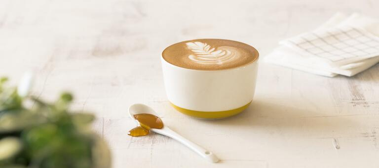 Flat white sweetened with honey