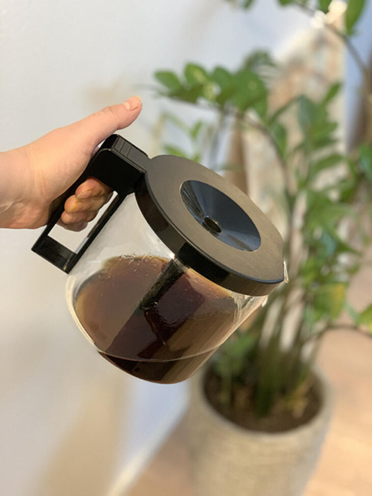 watering plant with coffee